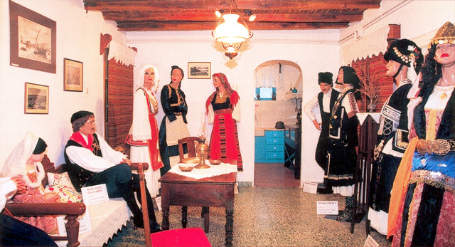FOLKLORE COLLECTION OF NAOUSSA - PAROS - The collection with the traditional customes that you'll see at the Folklore museum of Naoussa.
