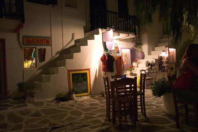 HANGING OUT IN NAOUSSA - Nightime, warm night drinking daquiris on this small alley with the little tables outside. Can't wait till next summer... by Nikos Bournas
