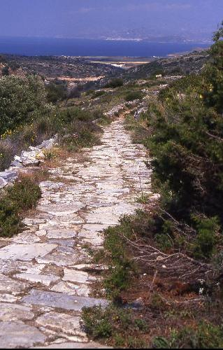 BYZANTINE WALKABOUT - The kalderimi is lined with old marble and takes you down through the rural countryside of eastern Paros for 3-4 km. Naxos is clearly visible across the narrow sea strait. We walked the ancient road alone on this day.