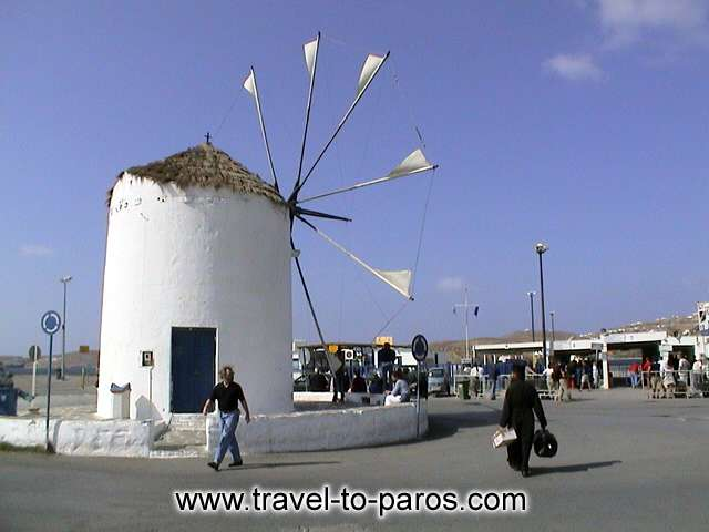 Symbol for the harbour of Paros constitutes the square with the windmill. PAROS PHOTO GALLERY - PARIKIA PORT
