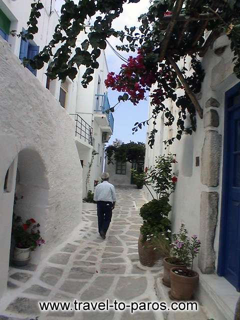 PARIKIA PAROS - The streets that are paved with slabs, the flowers, the cleanliness and the people are creating the unique atmosphere of Parikia.