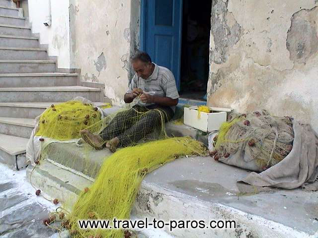 NAOUSSA FISHERMAN - The fisherman prepares his nets...