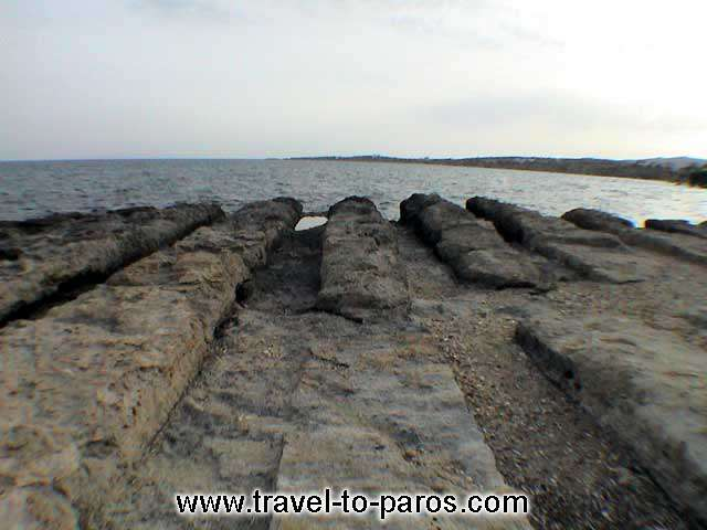 DRIOS - Wide and big stones with big lines in between which are the ruins of an ancient shipyard.